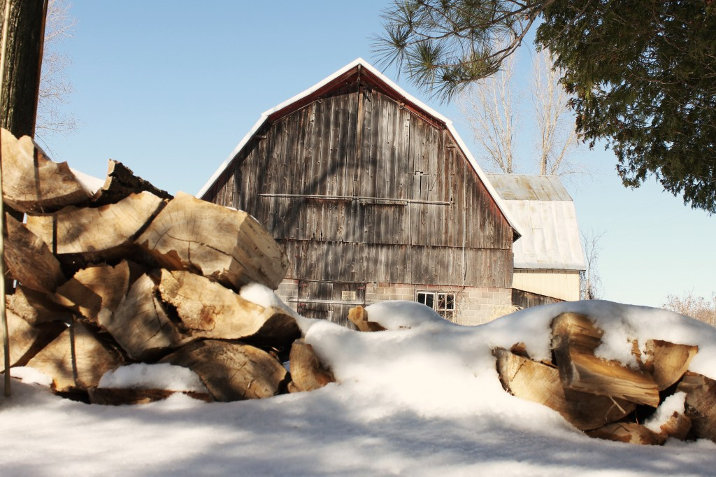 barn in snow with lumber