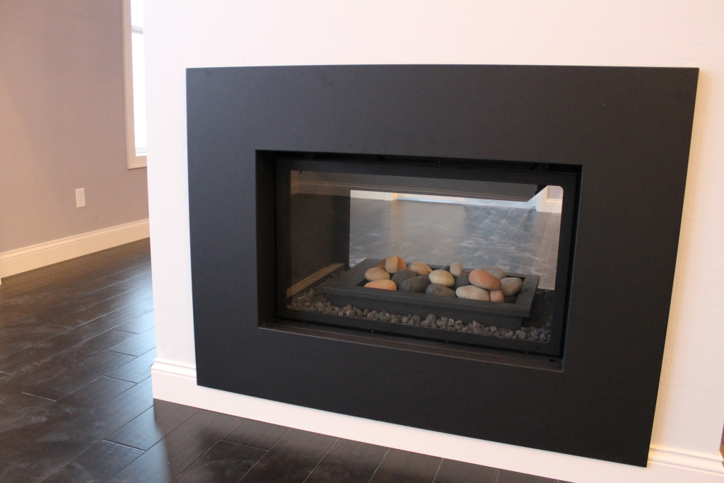 double sided fireplace with rocks