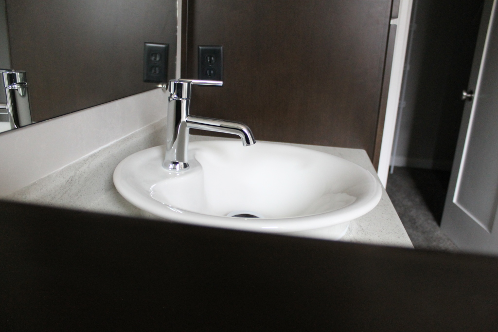 raised sink with modern faucet