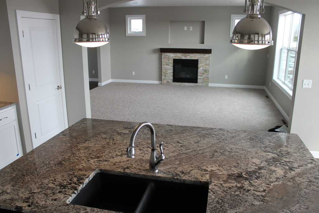 H granite island with industrial pendants