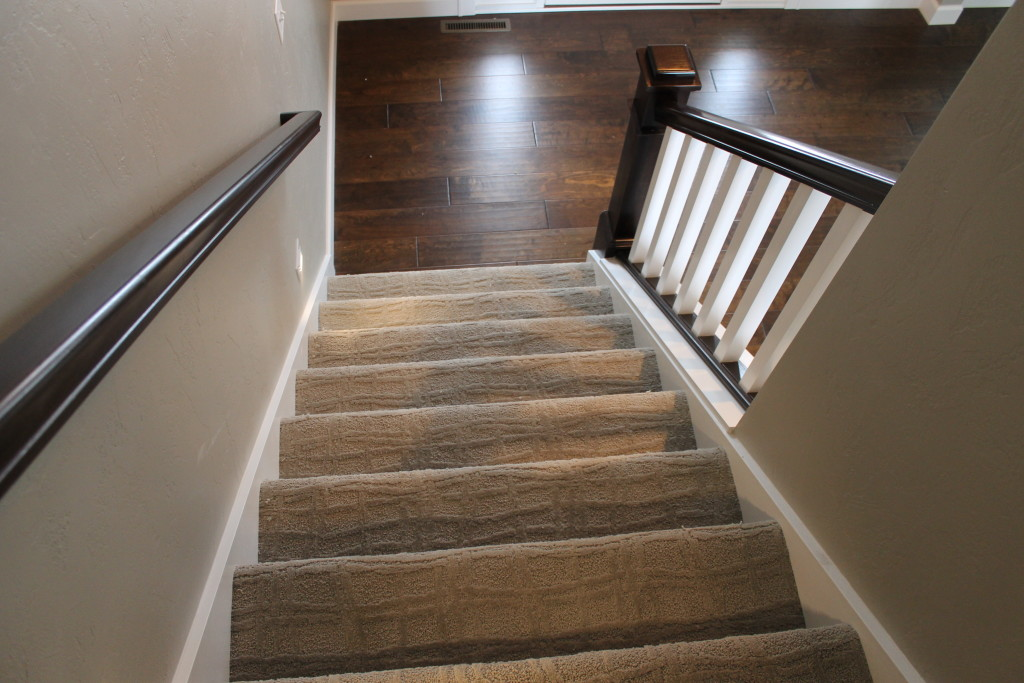H open stairs with hardwood foyer