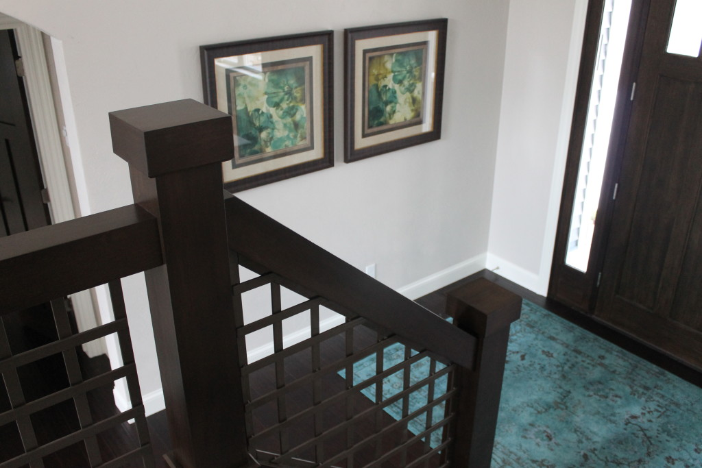 foyer with turquoise rug