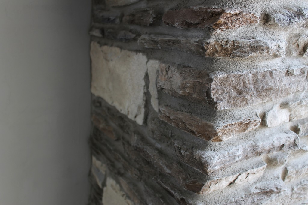 rustic stone detail clover fireplace