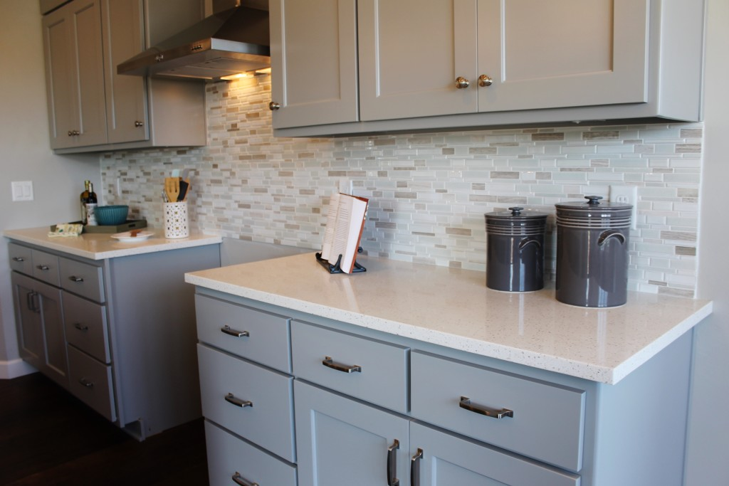 grey cabinets with mosaic backsplash