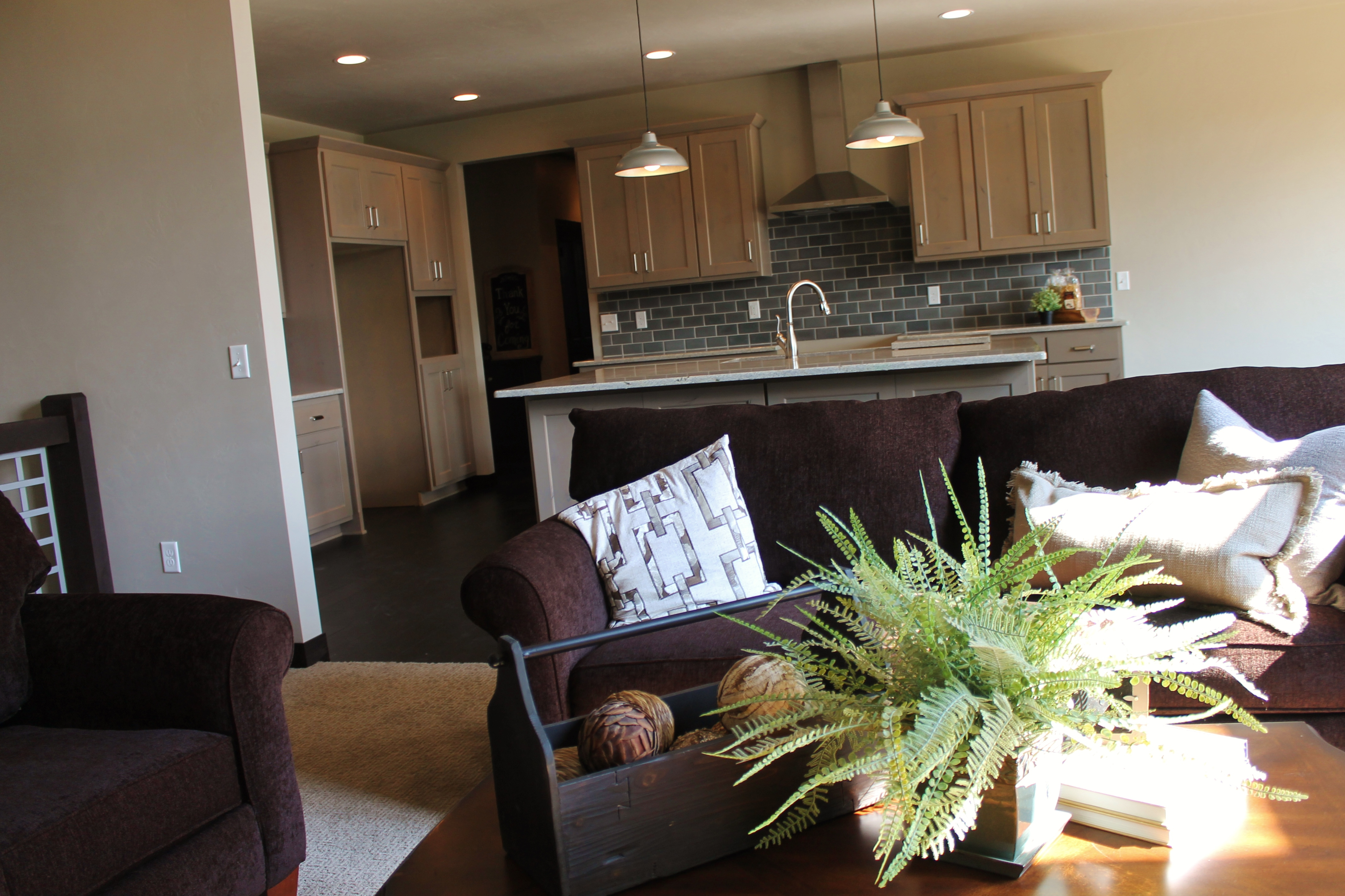 Tour the newest ranch design at 3717 mighty oak katie for Open concept living room