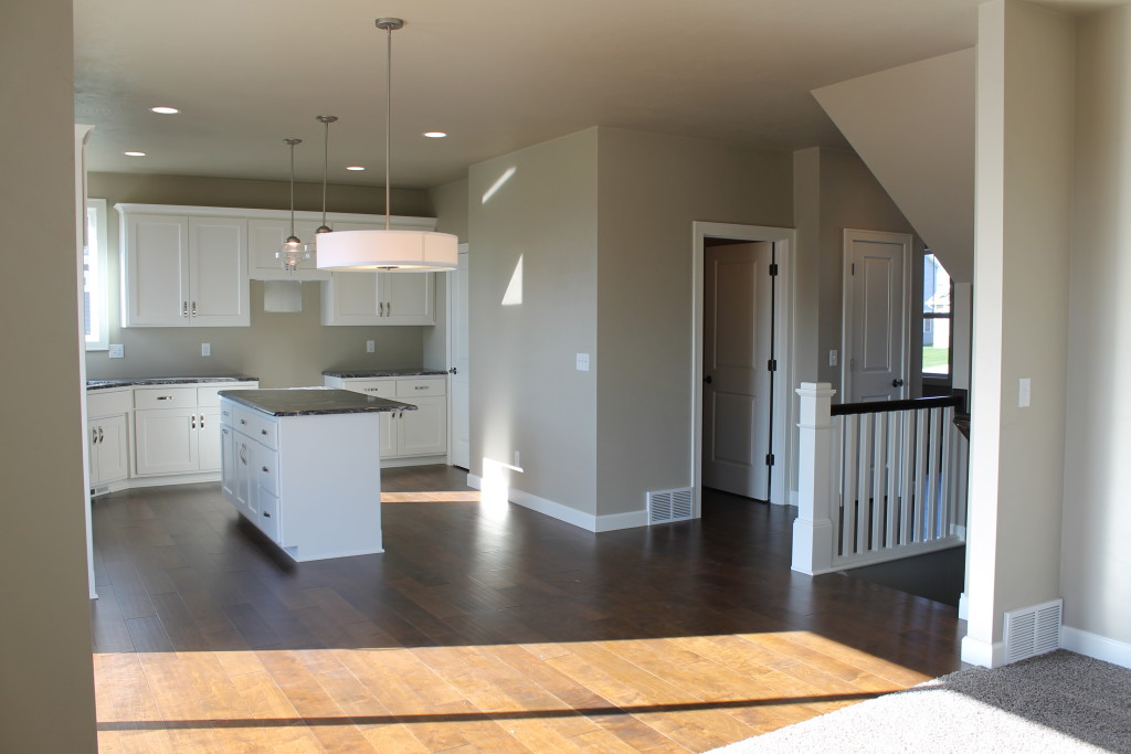 open concept kitchen with stairs open to lower level 5951 daffodil