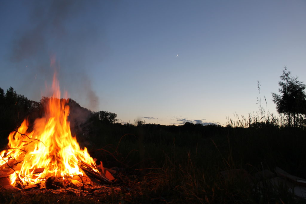 fire in field with sliver moon2016