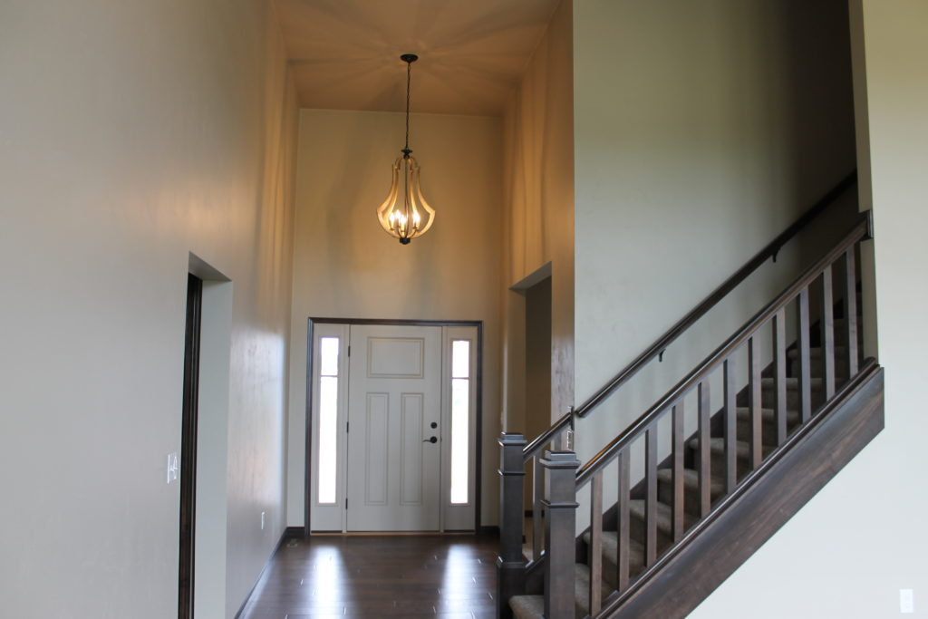foyer with open stairs and light at amethyst