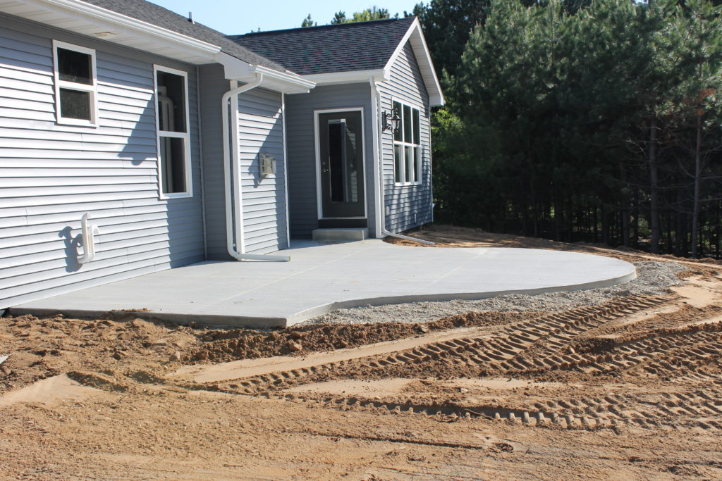 millers backyard with curved patio