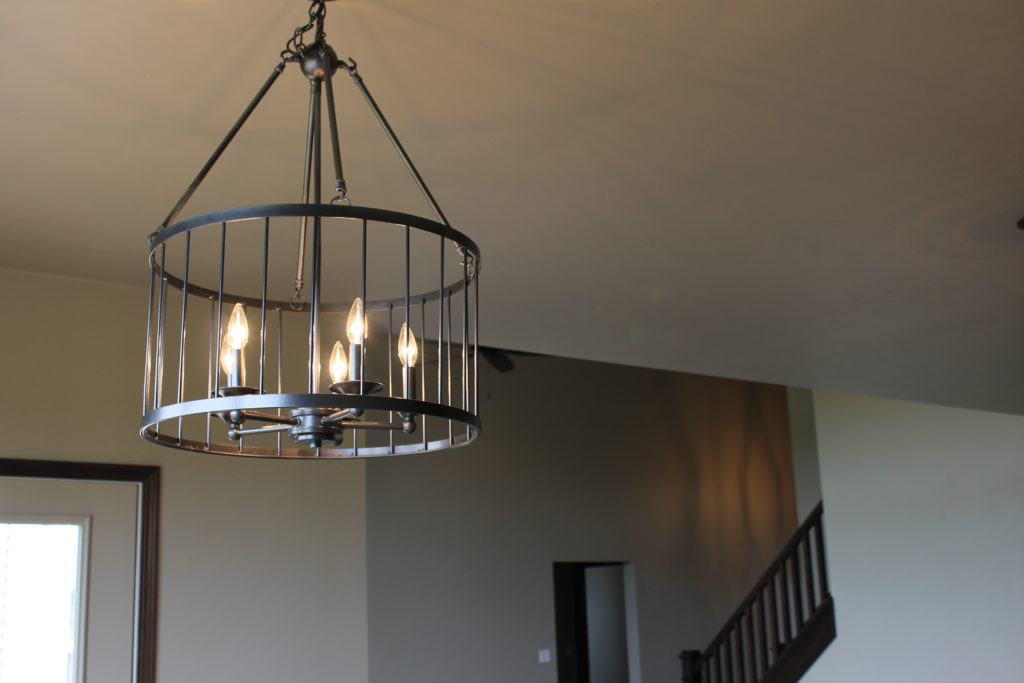 round cage light in dining nook