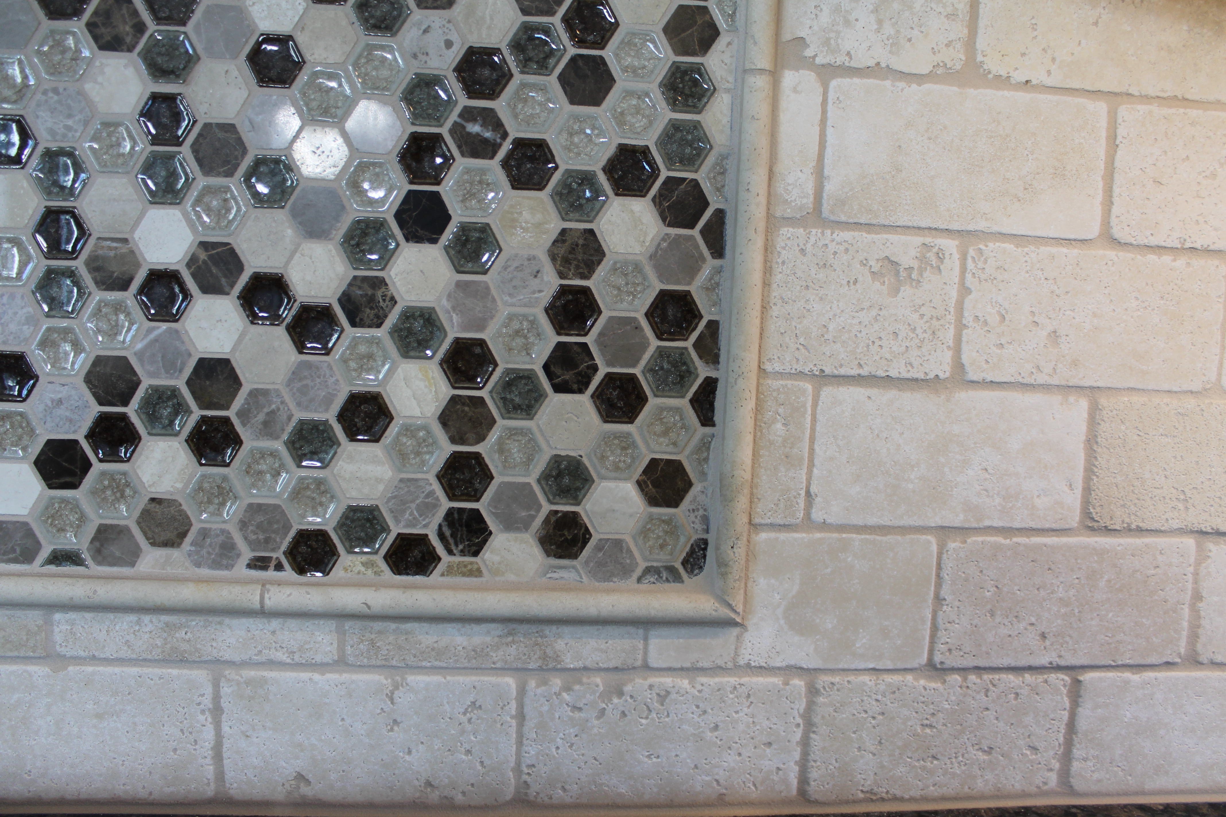 Two trends that are showing up in all of our custom kitchens close up on dake octagon backsplash tile with border dailygadgetfo Images