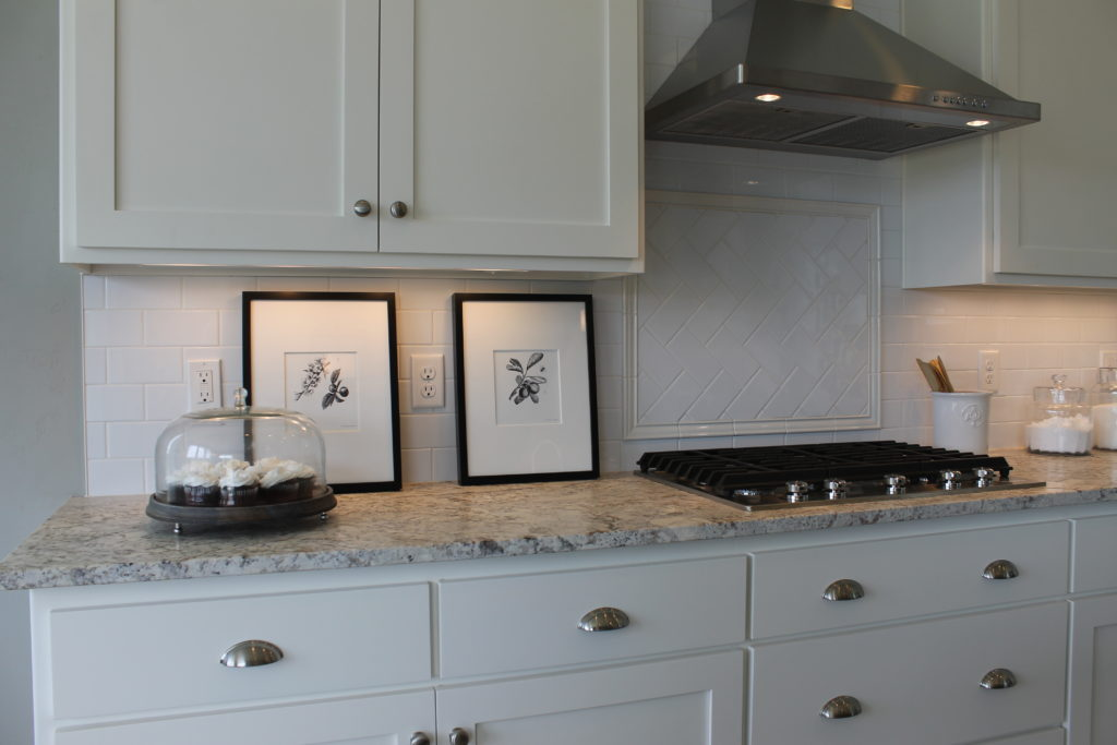 black and white pictures in a black and white kitchen