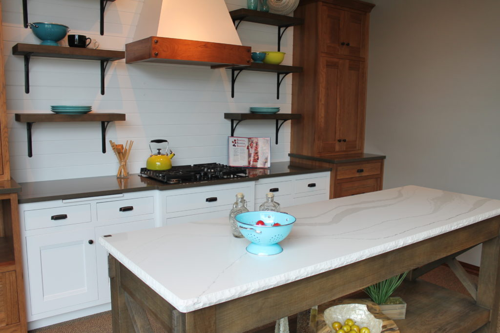 farmhouse-kitchen-with-mix-of-white-and-stained-cabinets