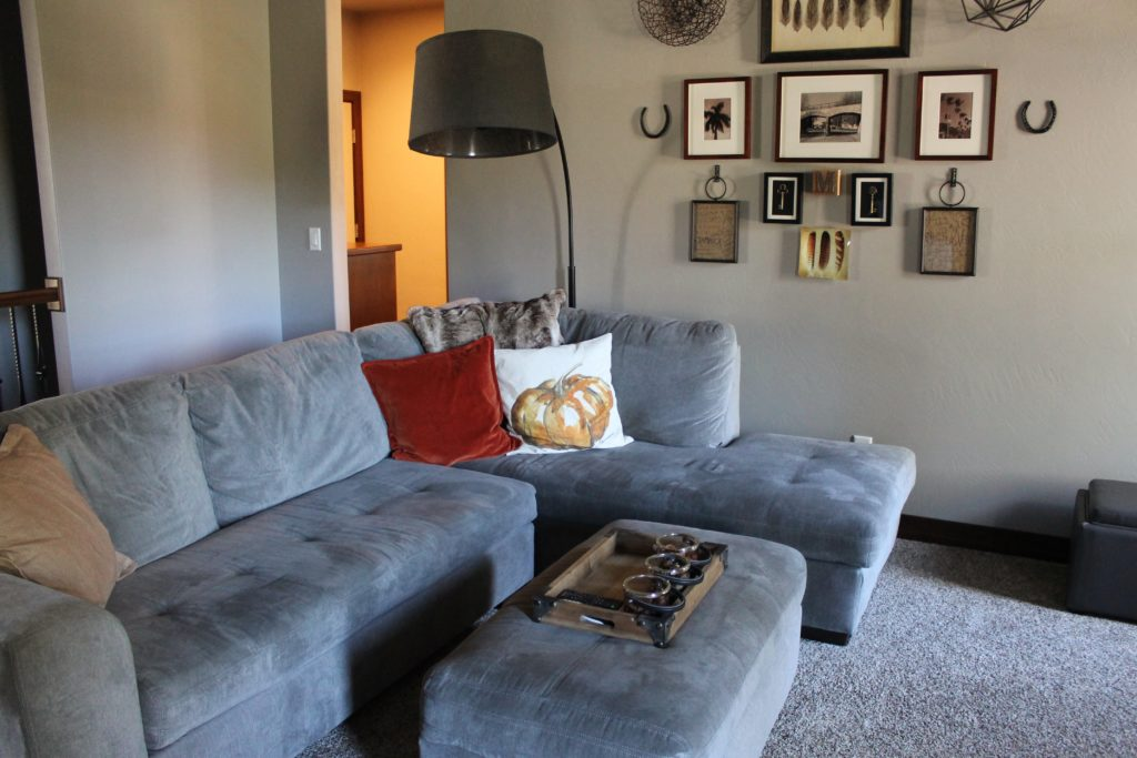 living-room-with-pumpkin-pillow-and-photo-wall