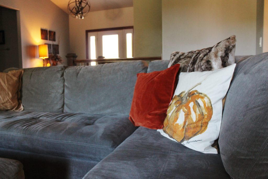 living-room-with-pumpkin-pillow-looking-at-foyer