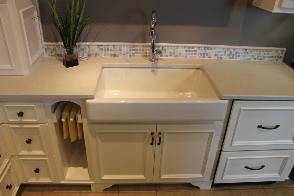 white-farmhouse-sink-with-white-cabinets