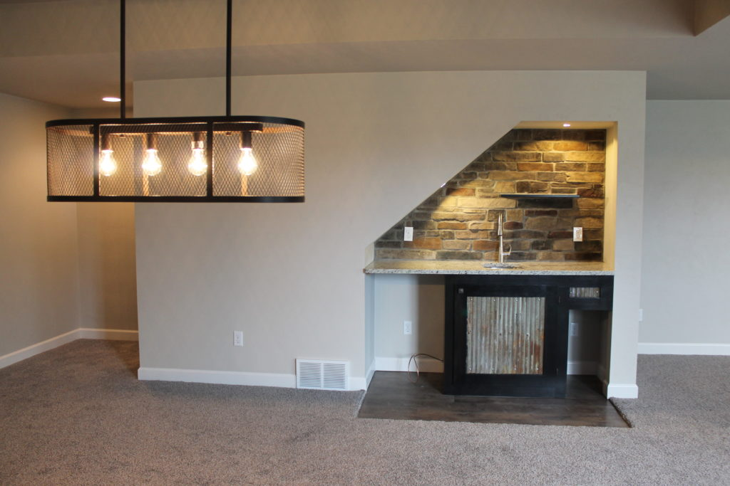bar-area-under-stairs-at-the-prescott-westbury-finished-lower