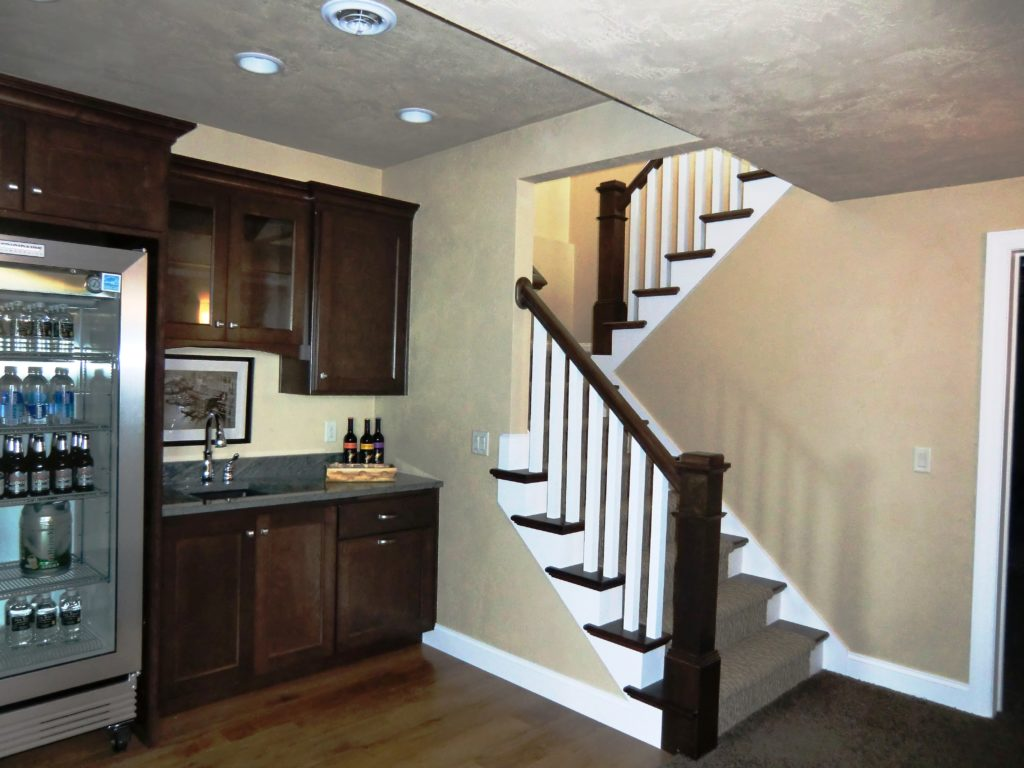 small-bar-area-tucked-under-a-u-shaped-stairs