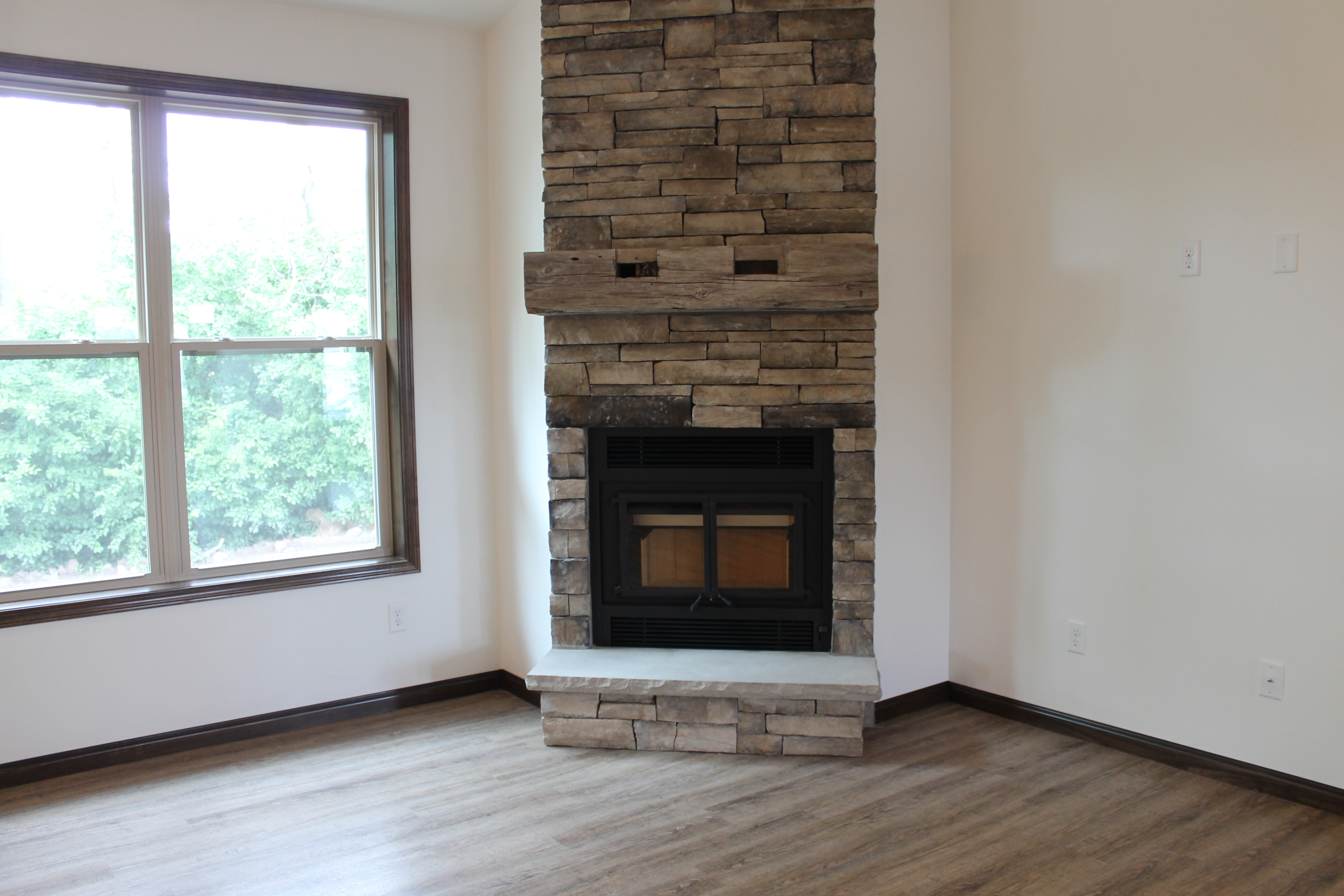 Fireplace Raised Hearth. It showcases a raised hearth  reclaimed barn beam mantel and stone on the face of angle with plastered returns side Fireplace Designs Rustic Mantel Trend Katie Jane Interiors