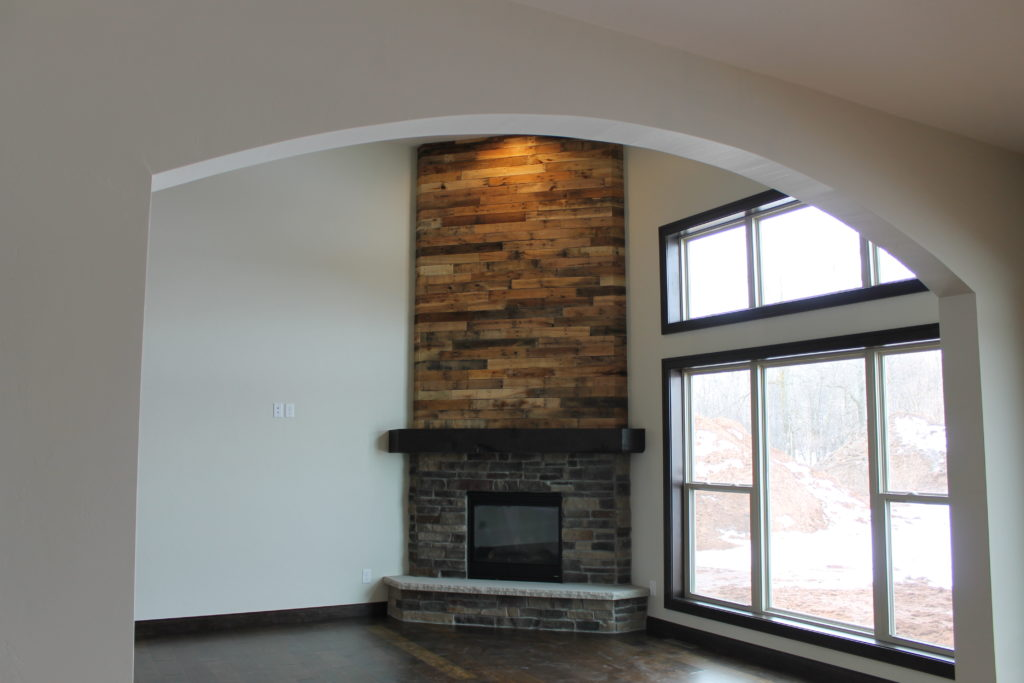 Fireplace designs and the rustic mantel trend katie for Corner fireplace framing plans